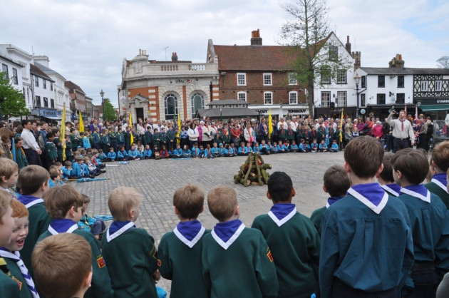 Hitchin District Scout camp fire in the Market Square for St George's Day parade 2014